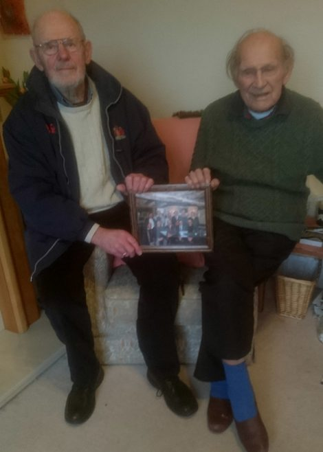 Lionel, John Davis and the framed photograph.