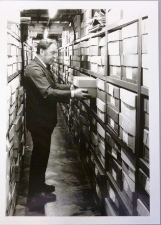 Photo of Arthur Rigby in a document strongroom at Gloucestershire Record Office, mid-1980s
