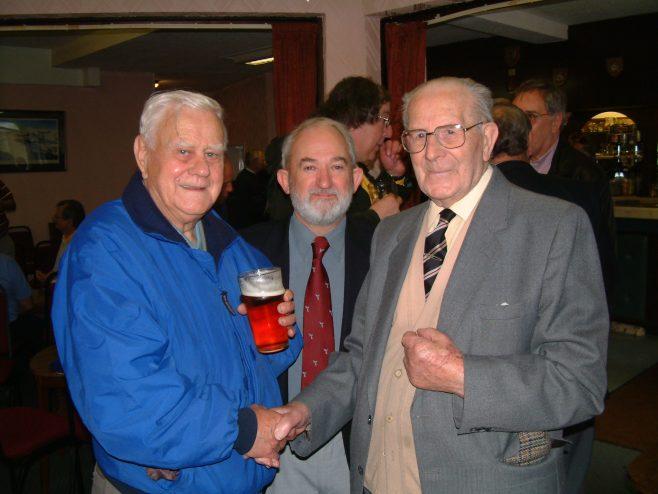 Photo 12.    Bob Madeley;  ?  ; Stan Curtis.