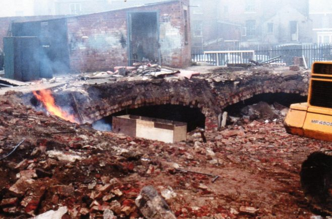 Photo 19.  Demolition of the old bike sheds and crypt, c.1980.