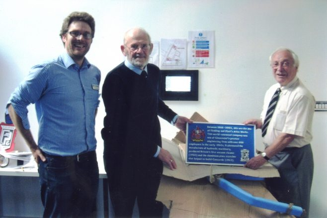 Photo 81.  Olly Taylor; John Davis & Brian Mince showing the commemorative Blue Plaques, prior to location in the Gloucester Quays shopping outlet.