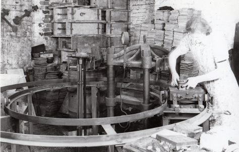Small Tile Press with operator shown stripping tile and removing cores, c.1943