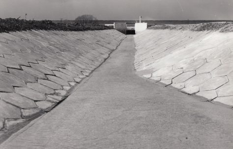 Irrigation canal using pressed concrete interlocking slabs, photographs c.1970, O/No. K75680, c.1969