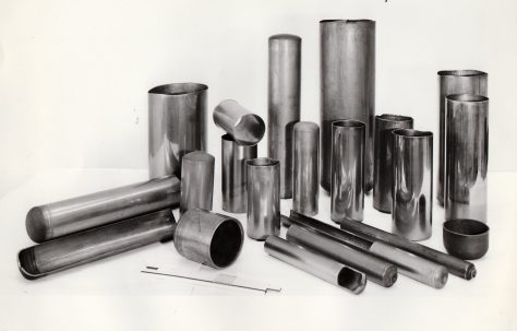 A selection of closed-end Steel cans, half-sections and struts, c.1971