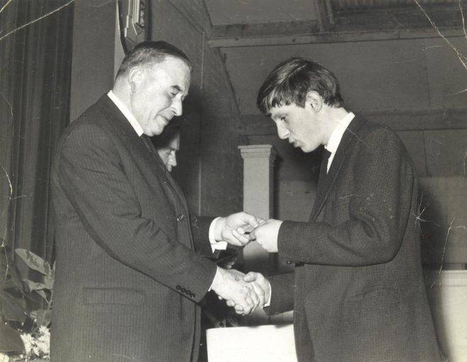 Graham Aston (right) receiving a prize in the canteen, 1967 | Graham Aston