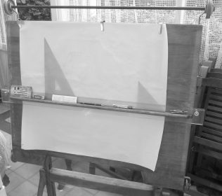 John describes his early drawings and the drawing board he used.