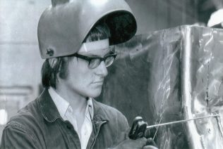 Gordon in the Fabrication Workshop working on sheet metal housing for a Slab Press, c. 1974