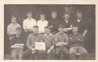 In this picture taken on the outward bound course, Martin can be seen on the back row, on the far left