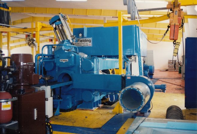 JB372  Front of press with forced-air extrusion cooling fan in foreground | Supplied by John Bancroft