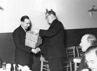 Arthur Rigby receives a prize from Roy Peglar. Bert Ely & Brian Billingham? look on.