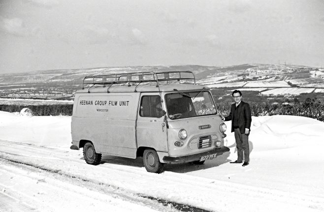 The Heenan Group Film Unit's first transport, a Morris Van. Taken in the winter of 1964/1965 on the Heads of the Valley road in Wales, following a film shoot of 1128 ton Shear at Birds (Swansea) Ltd., Scrap Metals, Bynea, Nr. Llanelli.  Brian Mince (standing), driver Ron Gordon from Worcester Unit. Pete Skelton behind the camera. | Kindly supplied by Pete Skelton