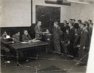 Ken Court is pictured in the middle of the three seated at the table