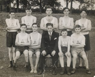 The Apprentice Sports Team, Ken is in the middle of the front row wearing a suit